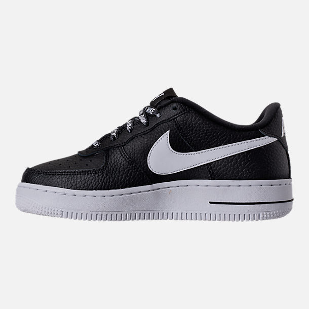 Left view of Boys' Grade School Nike NBA Air Force 1 Low LV8 Casual Shoes in Black/White