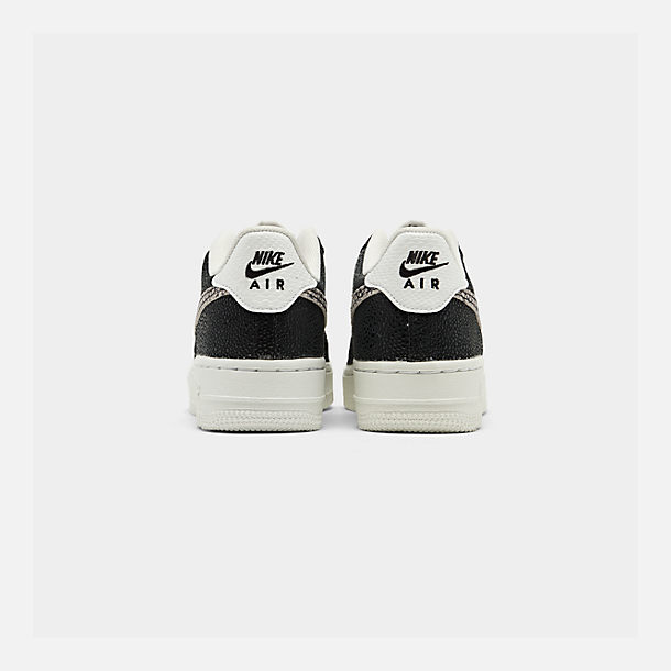 Left view of Boys' Big Kids' Nike NBA Air Force 1 Low LV8 Casual Shoes in Summit White/Black