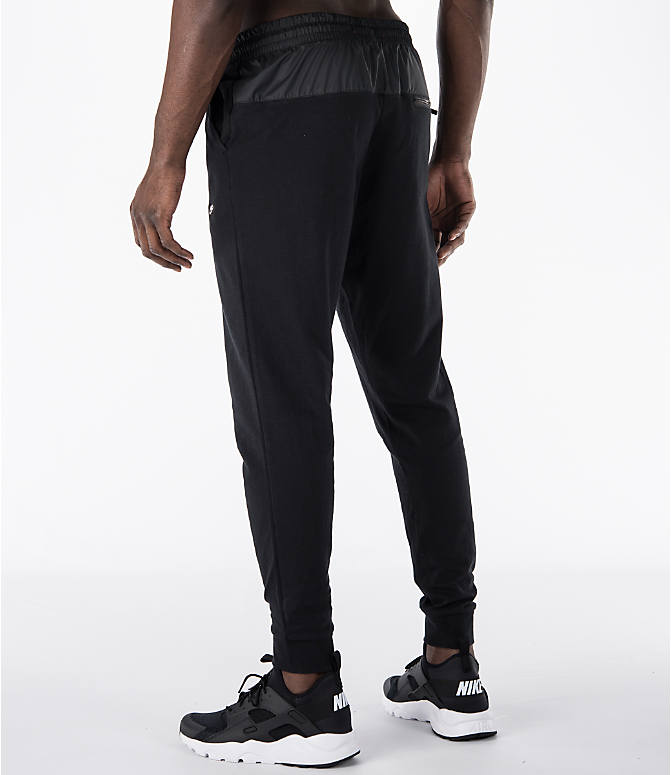 Back Left view of Men's Nike Sportswear Modern Jogger Pants in Black
