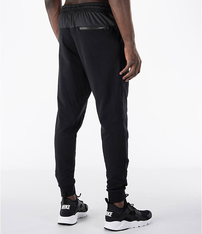 Back Right view of Men's Nike Sportswear Modern Jogger Pants in Black