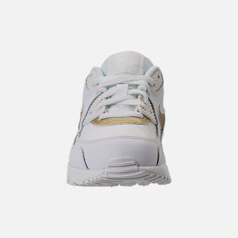 Front view of Girls' Preschool Nike Air Max 90 Leather Running Shoes in Summit White/Metallic Gold Star