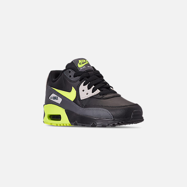 Three Quarter view of Big Kids' Nike Air Max 90 Leather Casual Shoes in Dark Grey/Volt/Black/Light Bone