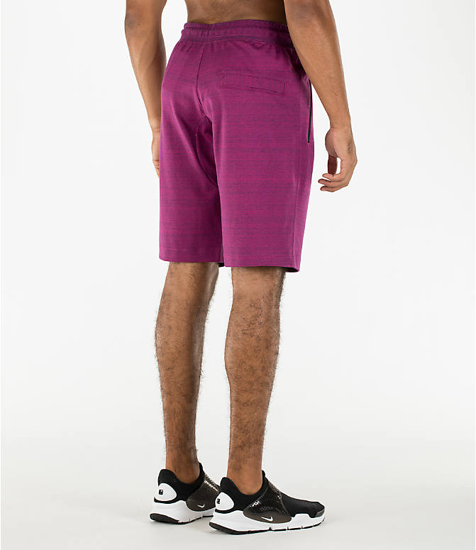 Back Right view of Men's Nike Sportswear AV15 Knit Shorts in Berry