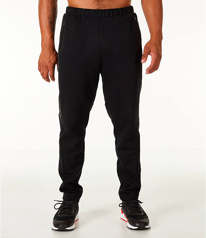 Front Three Quarter view of Men's Puma Evostripe Training Pants in Black/White