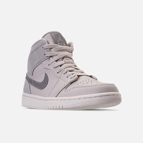 Three Quarter view of Men's Air Jordan Retro 1 Mid Premium Basketball Shoes in Light Bone/Grey Fog/Reflect Silver