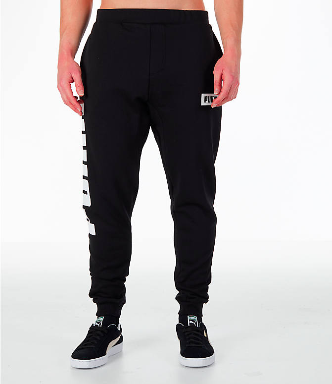 Front Three Quarter view of Men's Puma Rebel Cuffed Jogger Pants in Black