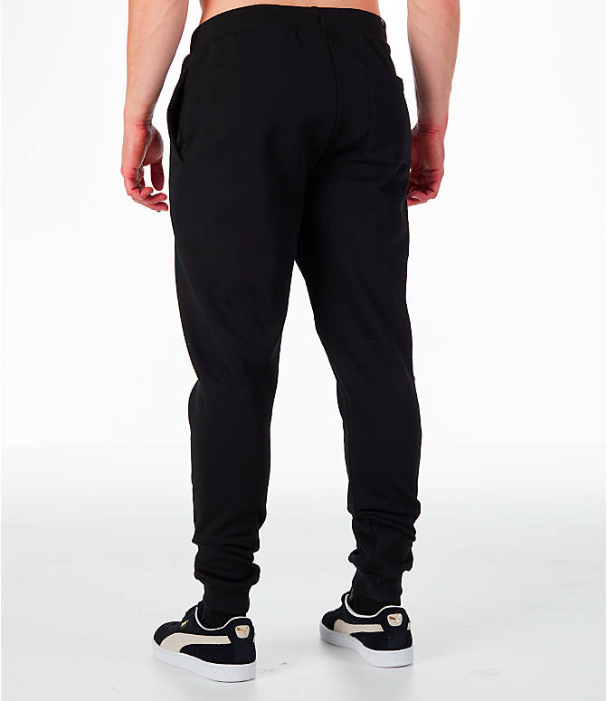 Back Left view of Men's Puma Rebel Cuffed Jogger Pants in Black
