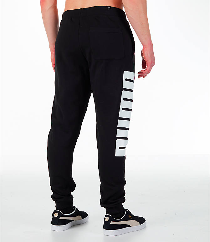 Back Right view of Men's Puma Rebel Cuffed Jogger Pants in Black