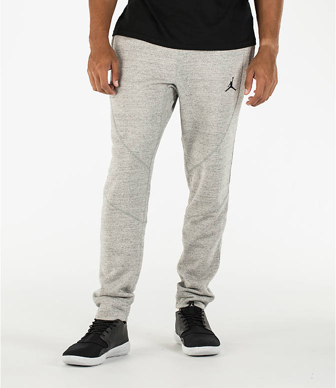 Front view of Men's Air Jordan Wings Fleece Jogger Pants in Dark Grey