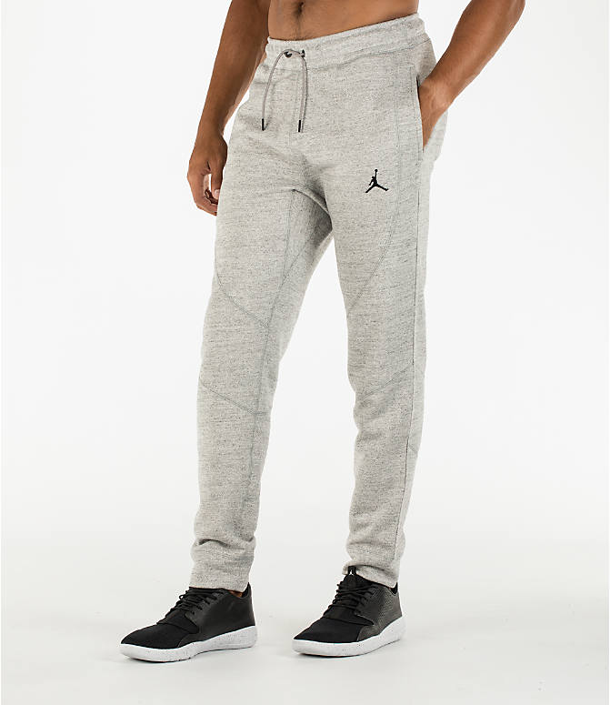 Front Three Quarter view of Men's Air Jordan Wings Fleece Jogger Pants in Dark Grey