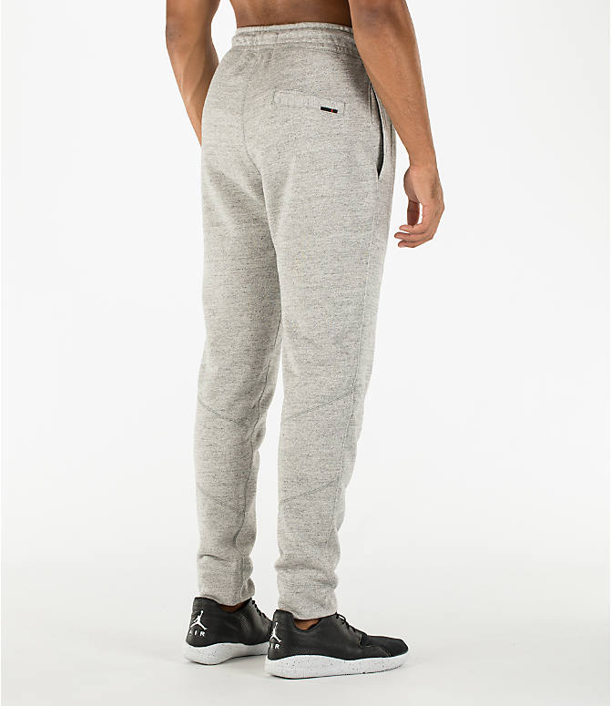Back Right view of Men's Air Jordan Wings Fleece Jogger Pants in Dark Grey