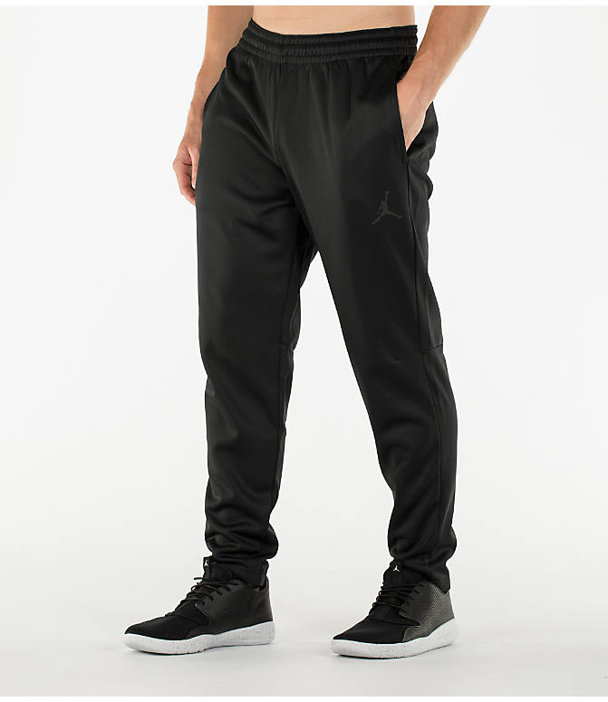 Front Three Quarter view of Men's Air Jordan 23 Alpha Therma Training Pants in Black