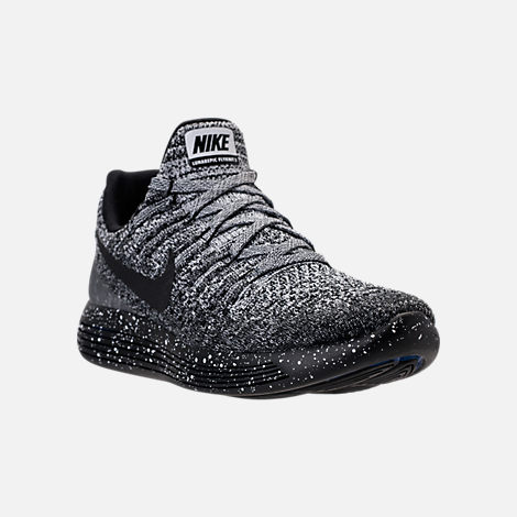 three quarter view of womens nike lunarepic low flyknit 2 running shoes in black white