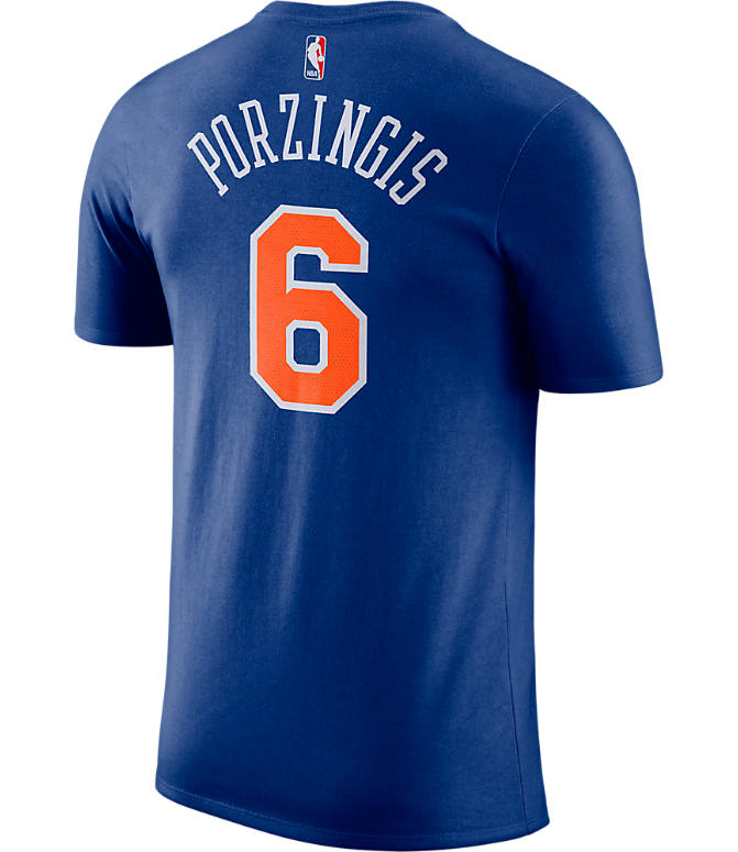 Front view of Men's Nike New York Knicks NBA Kristaps Porzingis Name and Number T-Shirt in Rush Blue