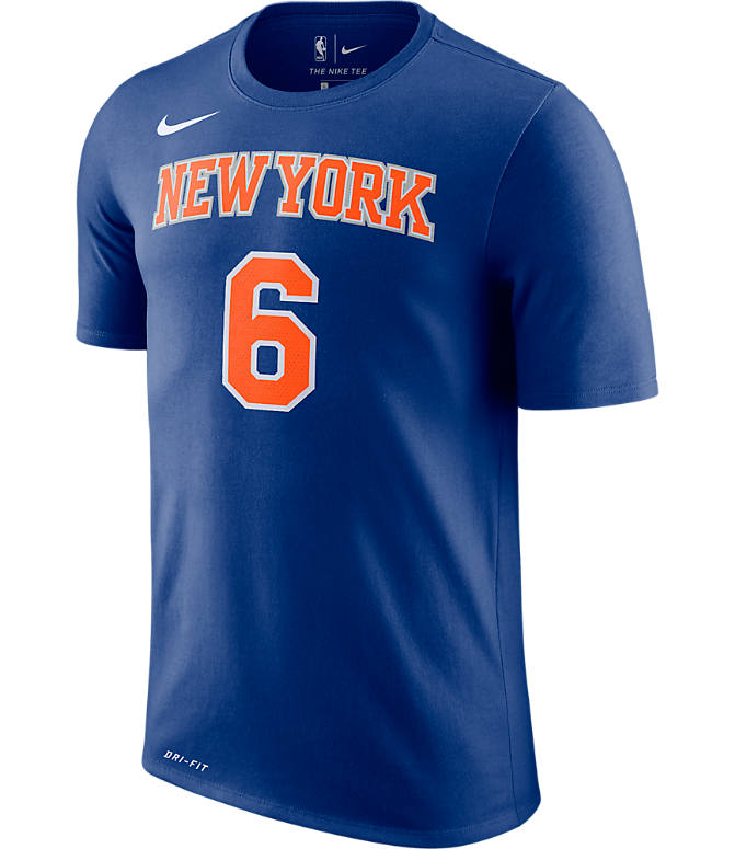Back view of Men's Nike New York Knicks NBA Kristaps Porzingis Name and Number T-Shirt in Rush Blue