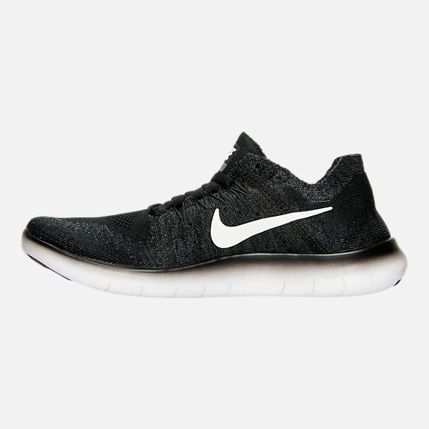 Left view of Boys' Grade School Nike Free RN Flyknit 2017 Running Shoes in Black/White/Anthracite/Volt