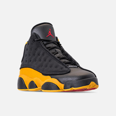 Three Quarter view of Big Kids' Air Jordan Retro 13 Basketball Shoes in Black/University Red/University Gold