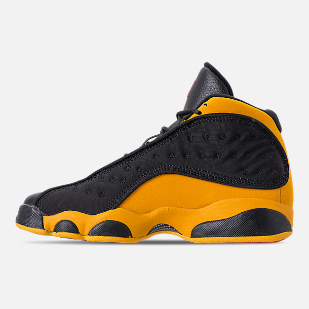 Left view of Big Kids' Air Jordan Retro 13 Basketball Shoes in Black/University Red/University Gold