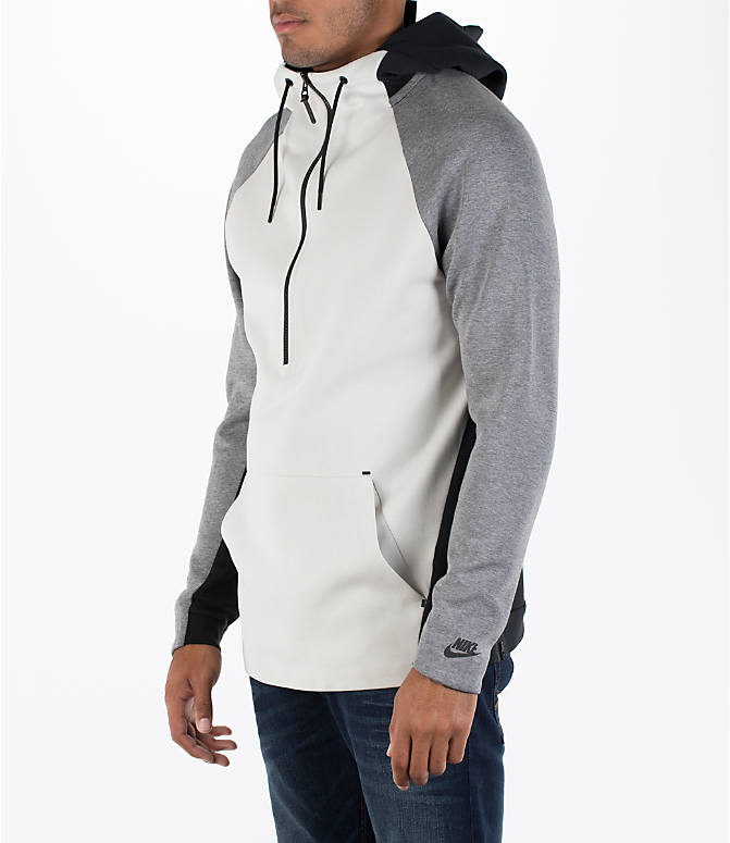 Front Three Quarter view of Men's Nike Sportswear Tech Fleece Color-Block Hoodie in Light Bone