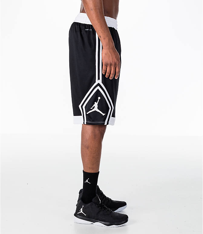 Front Three Quarter view of Men's Air Jordan Rise Diamond Basketball Shorts in Black/White