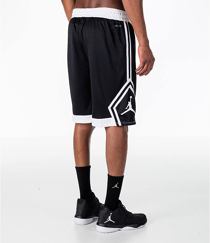 Back Left view of Men's Air Jordan Rise Diamond Basketball Shorts in Black/White