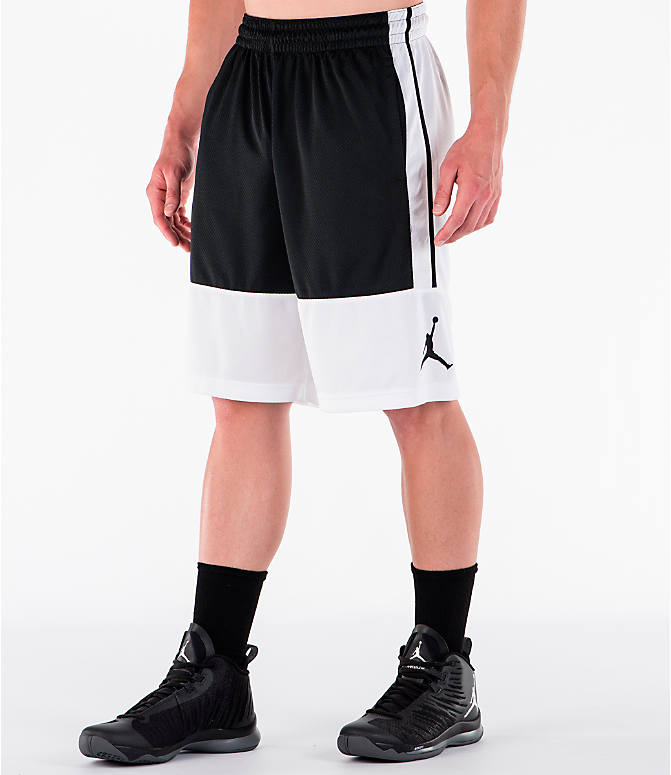 Front Three Quarter view of Men's Air Jordan Rise Solid Basketball Shorts in White/Black