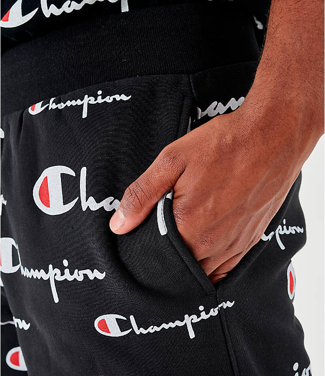 On Model 5 view of Men's Champion Reverse Weave Allover Print Script Shorts in Black