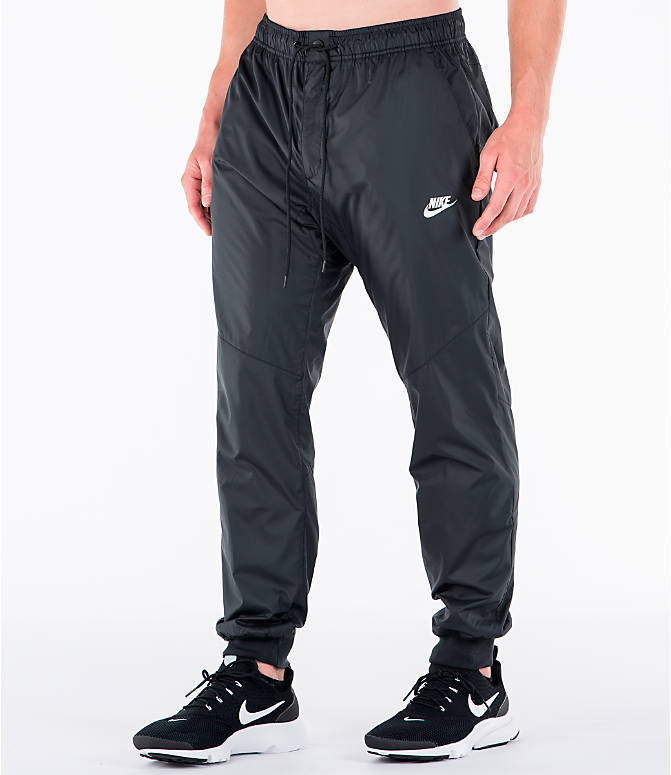 Front Three Quarter view of Men's Nike Sportswear Windrunner Jogger Pants in Black