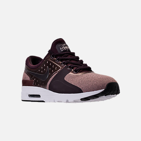 Three Quarter view of Women's Nike Air Max Zero Premium Running Shoes in Port Wine/Metallic Mahogany