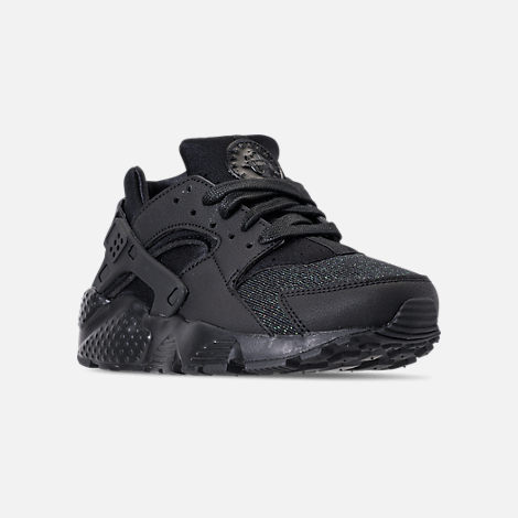 Three Quarter view of Girls' Big Kids' Nike Air Huarache Run SE Running Shoes in Black/Black