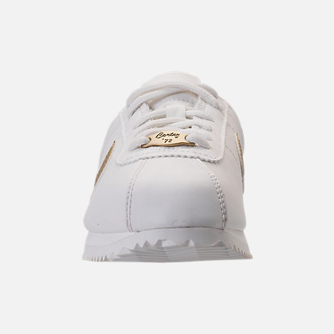 Front view of Boys' Grade School Nike Cortez Basic SL Casual Shoes in Summit White/Metallic Gold Star