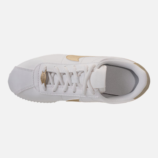 Top view of Boys' Grade School Nike Cortez Basic SL Casual Shoes in Summit White/Metallic Gold Star