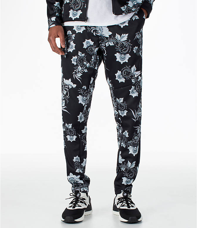 Front view of Men's Nike Sportswear Floral N98 Track Pants in Black/White