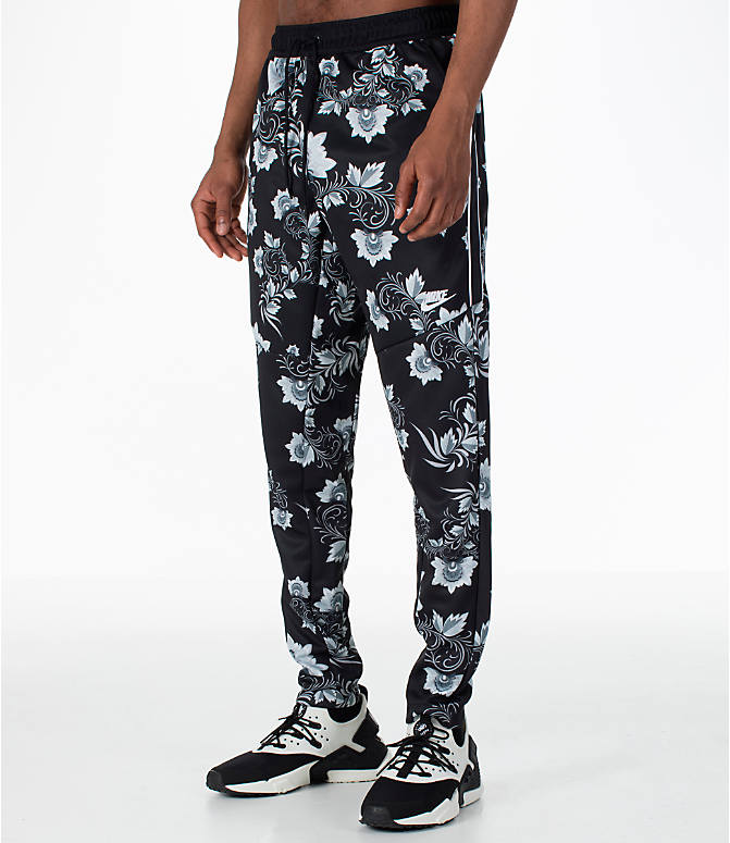 Front Three Quarter view of Men's Nike Sportswear Floral N98 Track Pants in Black/White