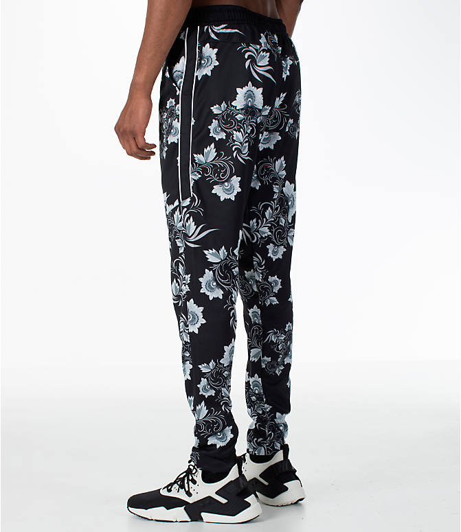 Back Left view of Men's Nike Sportswear Floral N98 Track Pants in Black/White