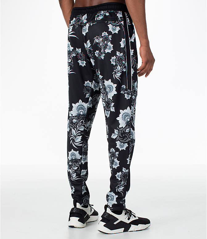 Back Right view of Men's Nike Sportswear Floral N98 Track Pants in Black/White