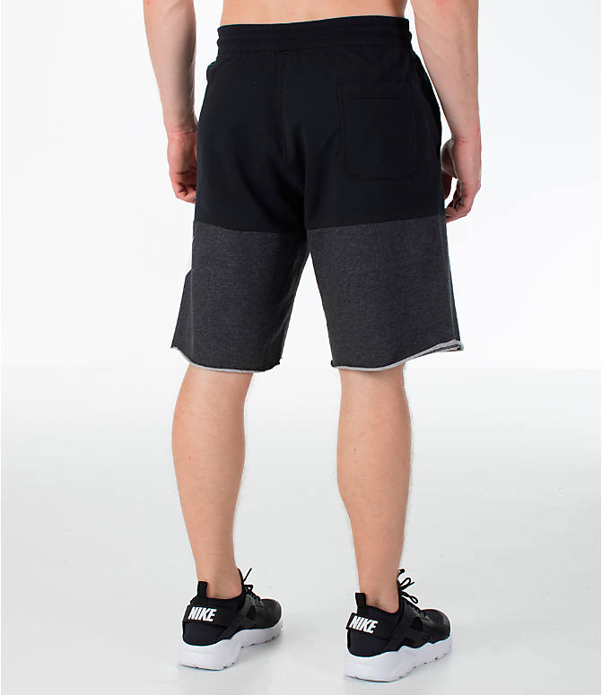 Back Right view of Men's Nike Sportswear Franchise Shorts in Black/White