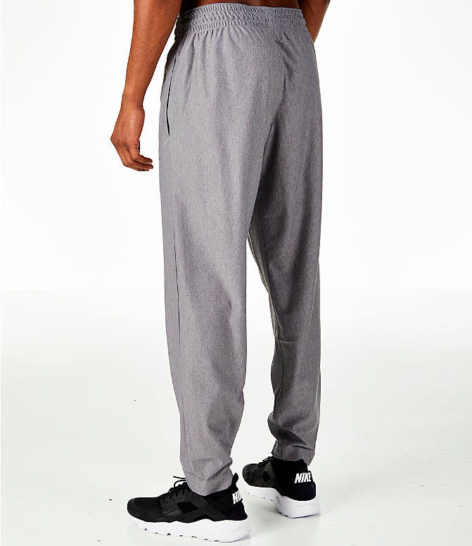 Back Left view of Men's Nike Transition Basketball Pants in Grey