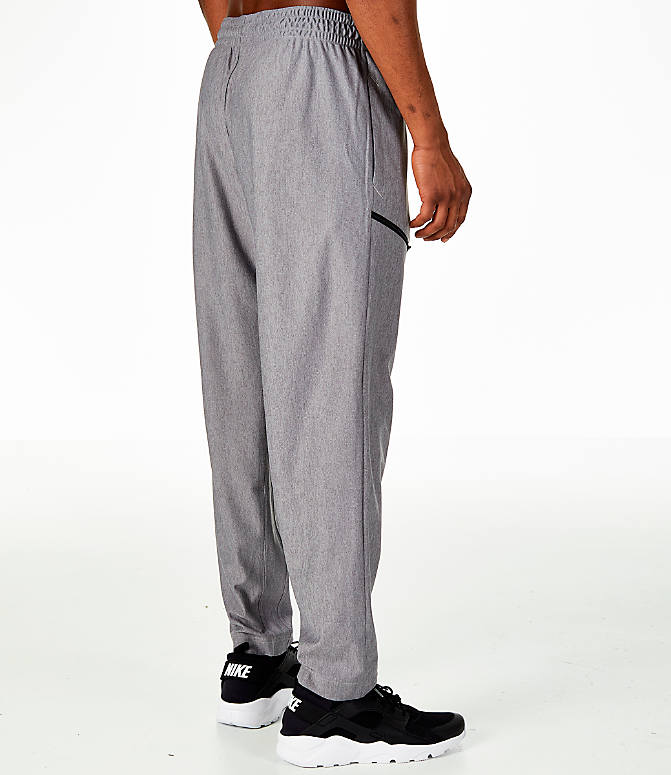 Back Right view of Men's Nike Transition Basketball Pants in Grey