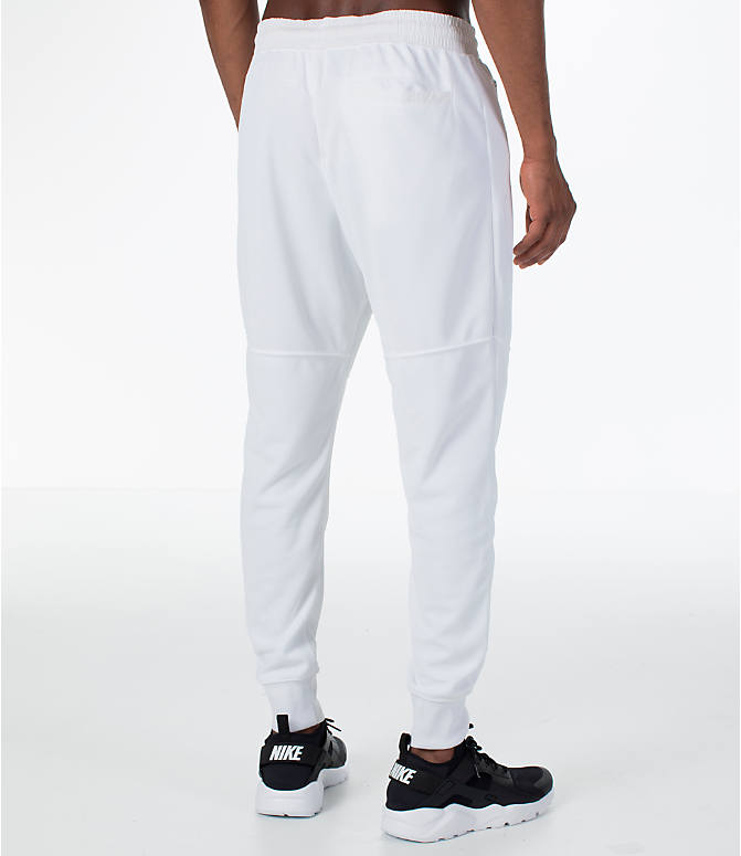 Back Right view of Men's Nike Sportswear Air Track Jogger Pants in White/White