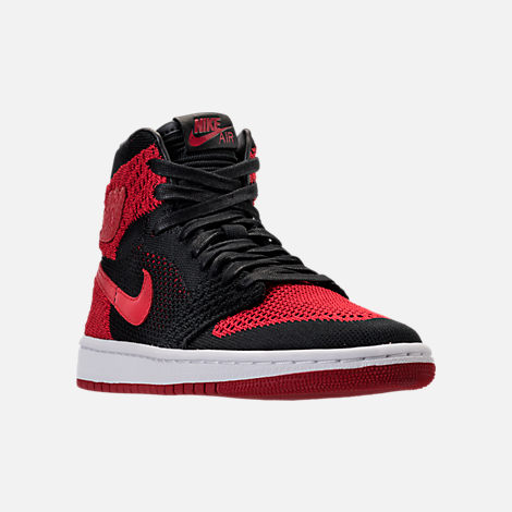 Three Quarter view of Boys' Grade School Air Jordan Retro 1 High Flyknit Basketball Shoes in Black/Varsity Red/White
