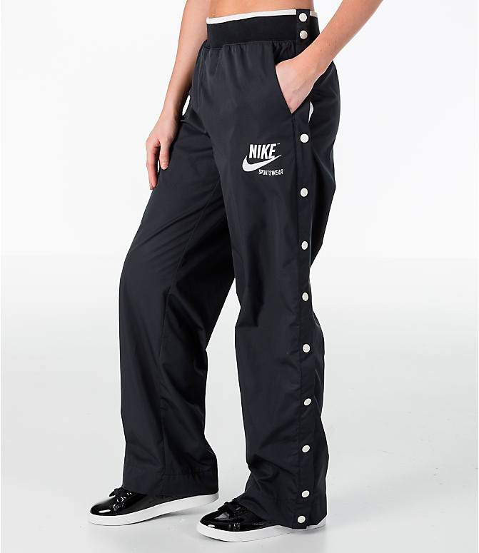 Front Three Quarter view of Women's Nike Archive Snap Training Pants in Black/Sail