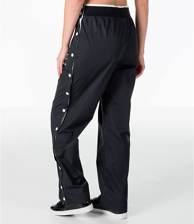 Back Left view of Women's Nike Archive Snap Training Pants in Black/Sail