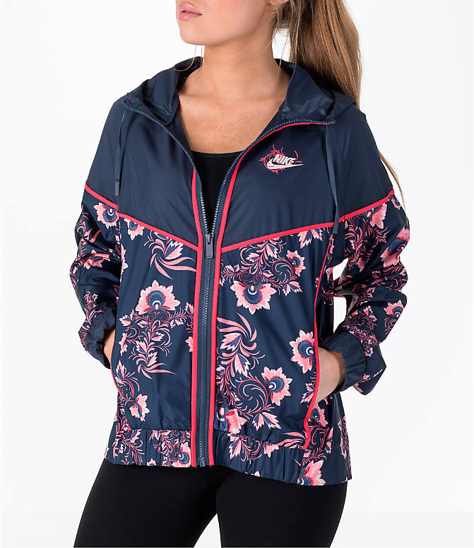 Front Three Quarter view of Women's Nike Sportswear Allover Print Windrunner Jacket in Thunder Blue/Floral