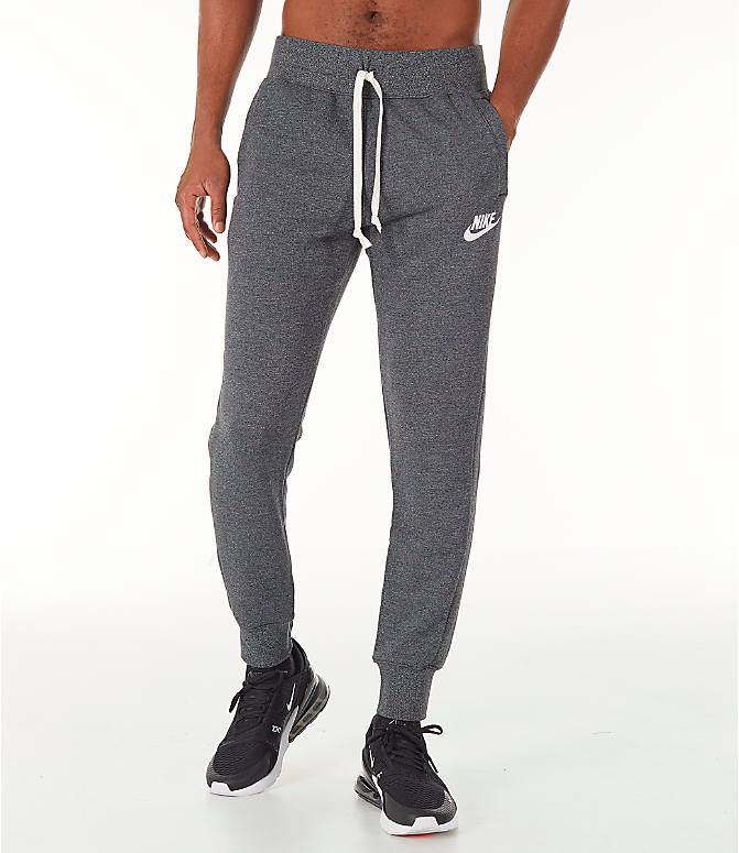 Front Three Quarter view of Men's Nike Sportswear Heritage Club Cuffed Jogger Pants in Heather Grey