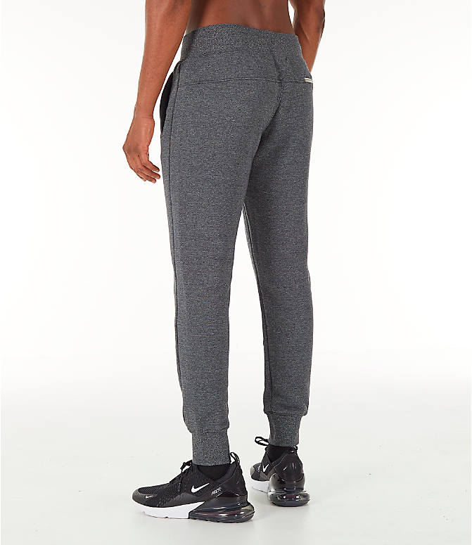 Back Left view of Men's Nike Sportswear Heritage Club Cuffed Jogger Pants in Heather Grey