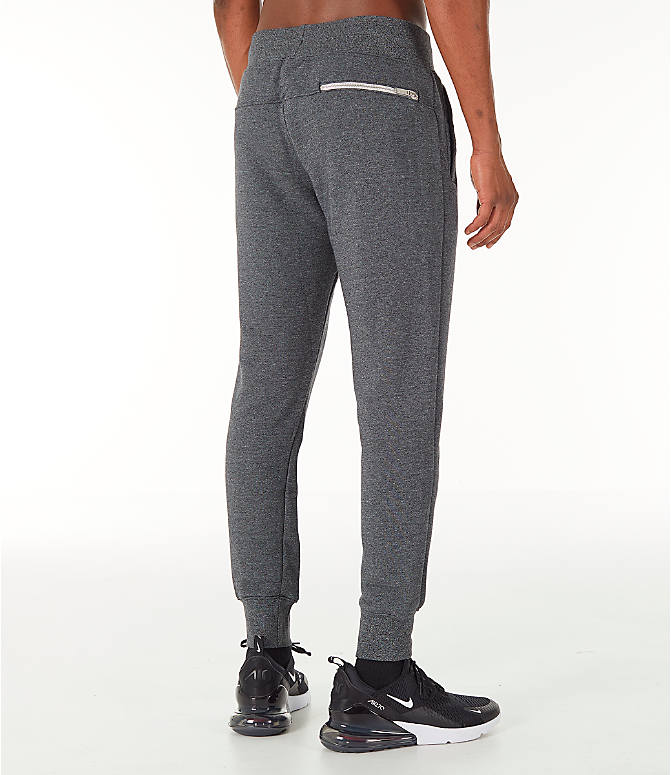 Back Right view of Men's Nike Sportswear Heritage Club Cuffed Jogger Pants in Heather Grey