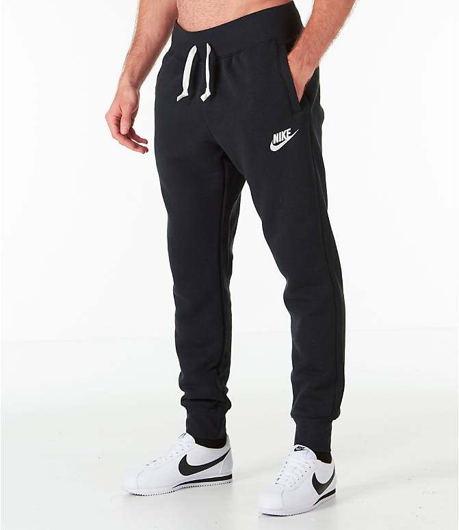 Front Three Quarter view of Men's Nike Sportswear Heritage Club Cuffed Jogger Pants in Black