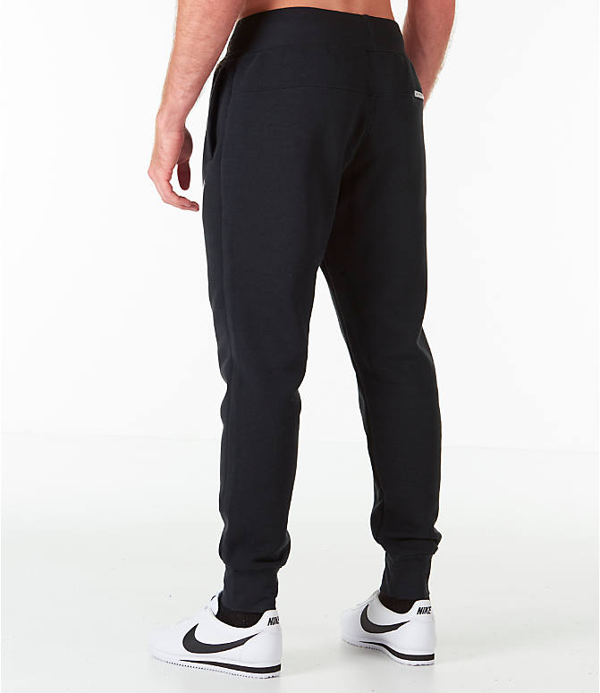 Back Left view of Men's Nike Sportswear Heritage Club Cuffed Jogger Pants in Black