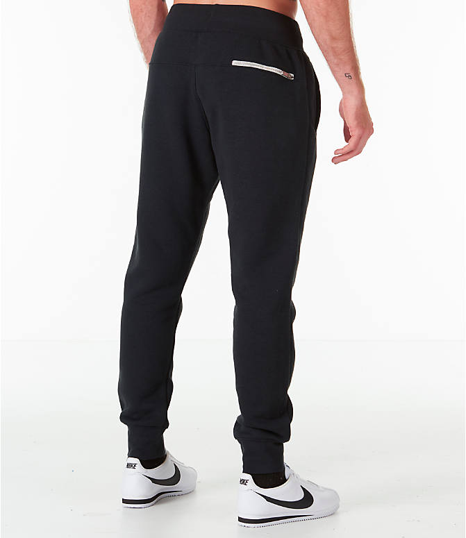 Back Right view of Men's Nike Sportswear Heritage Club Cuffed Jogger Pants in Black